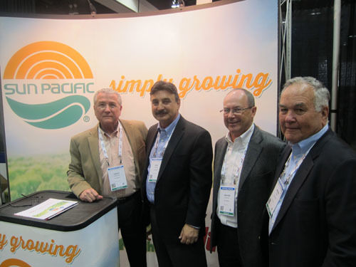 Louie de la Paz with Bob Dipiazza and Wayne McKnight and Berne Evans at the Sun Pacific booth