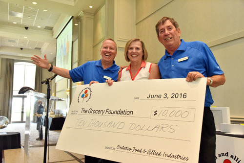 Cheque presentation - Chris Powell with Michelle Scott and Jim Hunter