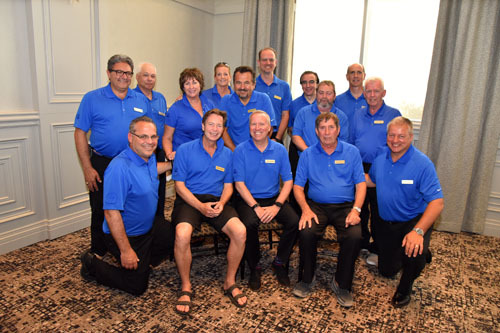 ront row: Sam Magnacca, Kevin Smith, Chris Powell, Jim Hunter, Denis Gendron. Back row: Forge Francella, Mike Marinangeli, Christine Tos, Michele McMillan, George Tzogas, Mike Furgiuele, Sal Galle, Peter Davies, Grant Campbell, Doug Cussons