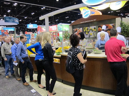 Lined up to try the delicious dishes created by the chef at the Sunkist booth