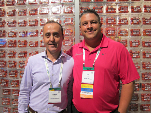 Robert Najm and Tom Coufal with a wall of Blushes Tomatoes form Lakeside Produce