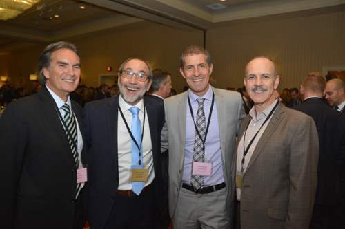 Pierre Charron of Metro Inc with Jim Slomka and Dave Iacobelli of Clorox Canada plus Domenic Calce of Metro Inc