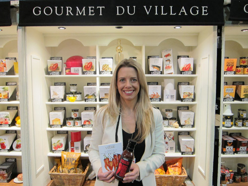 Ashley Tott with new Siracha Sauces from Gourmet du Village
