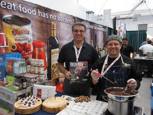 Tony Morello and Andy Mollica - Aurora Importing and Distributing Ltd - sampling fresh Baci chocolates