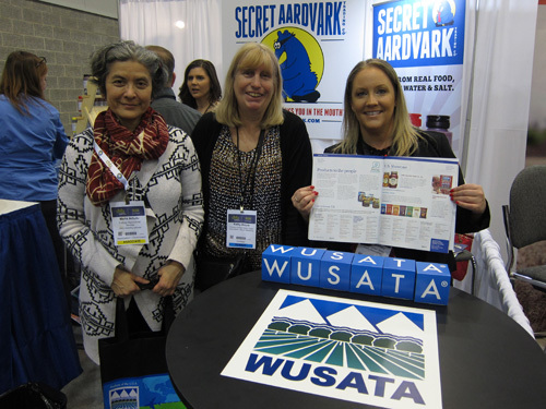 Maria Arbulu with Kathy Boyce and Janet Kenefsky at the Western United States Agricultural Trade Association booth