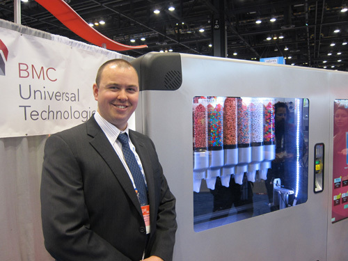 Robert Schwarzli with BMC Universal Technologies' traffic stopping Automated Candy Dispensing Machine