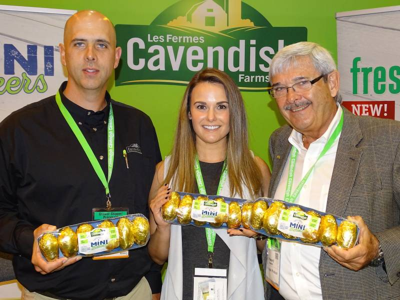 Left to right: Troy Havenga, Rebecca Wood and Edward Barnhill show off Cavendish Farms's Mini Bakers at the PMA Show.