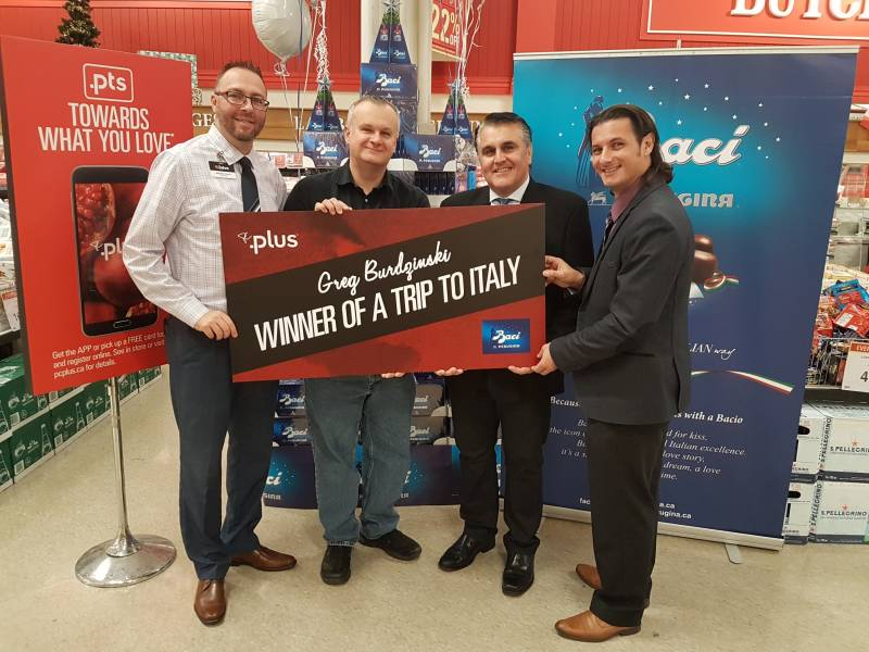 Sebastian Geraci, Zehrs Markets store manager; contest winner Greg Burdzinski, Gus Mosgopoulos and Frank Monaco, Aurora Importing and Distributing