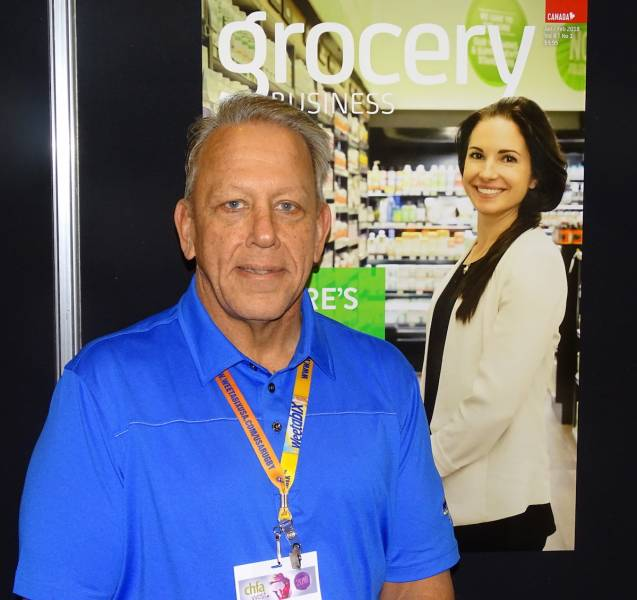 Scott Ryan of Natural Specialty Sales in the Grocery Business booth