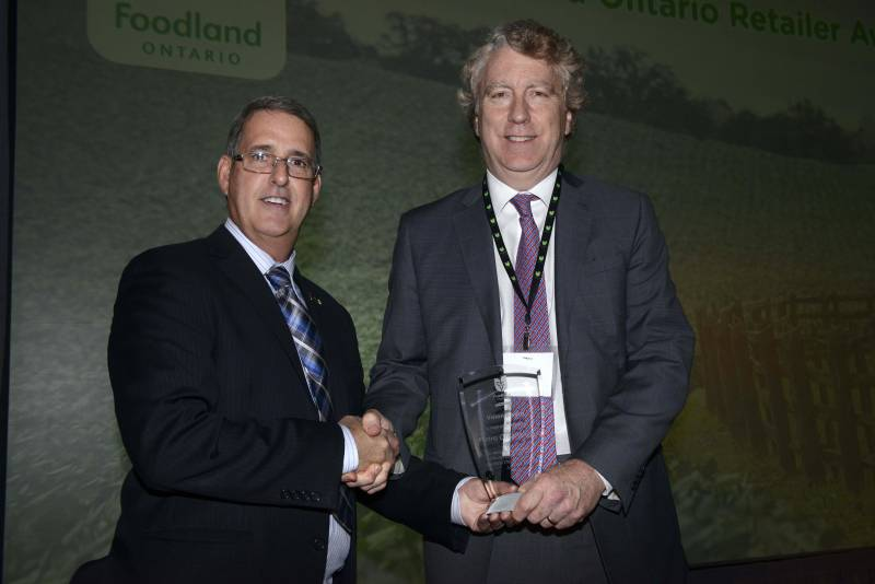 Andre Gagne of Metro receives the Foodland Ontario Vision Award from MPP Grant Crack (Glengarry-Prescott-Russell) for the company's outstanding corporate commitment to promoting Ontario Food.