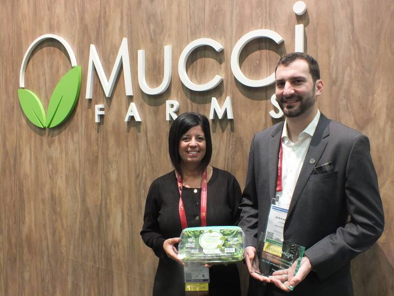 Emily Murracas and Stephen Cowan, Mucci Farms with the Mucci Farms snack sized Cute Cumcumber Poppers Freggie Approved product award