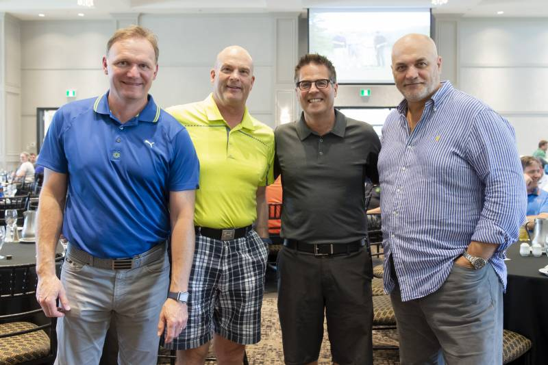 H. Kruger Inc's Steeve Lamontagne, Michel Manseau and Steve Turner, with Paul Bravi of Food Basics