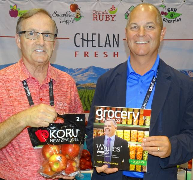 Stewart Lang (left) with Mac Riggan in the Chelan Fresh booth