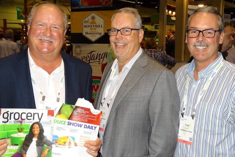 AG Brown & Sons Jim Brown (left) and Todd Watson (right) flank Fred Hunt of Nuvo Retail Group