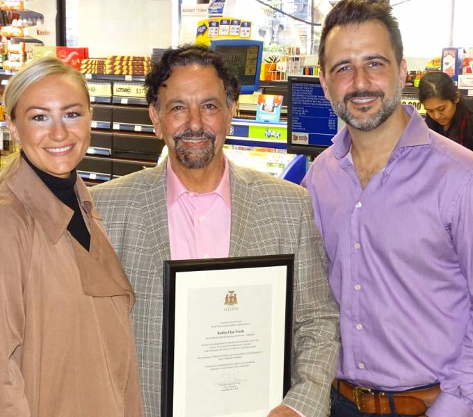 Etobicoke Centre MPP Kanga Surma, left, joins Ward 5 Councillor Justin Di Ciano, right, in congratulating Rabba Fine Foods founder Jack Rabba on the store redesign. Jack Rabba was presented with a celebratory scroll from the city.