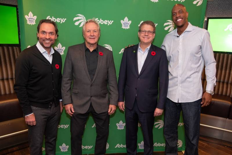 Former Maple Leafs Darcy Tucker (left) and Darryl Sittler with Sobeys' Michael Medline and (right) former Toronto Raptor Jerome Williams