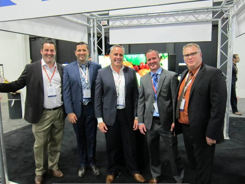 L R at Howell Data Systems booth: Corey Carter, Jamie Somers, Paul Howell, Jon Sutcliffe and Rory Howell