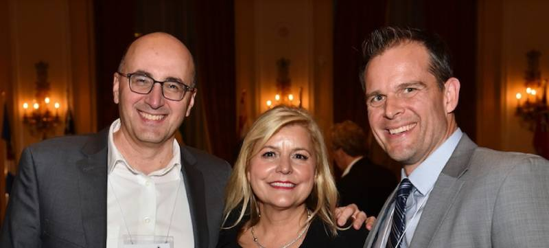 Nielsen's Steve Matresky and Mike Ljubicic with Mary Dalimonte, Golden pencil honouree