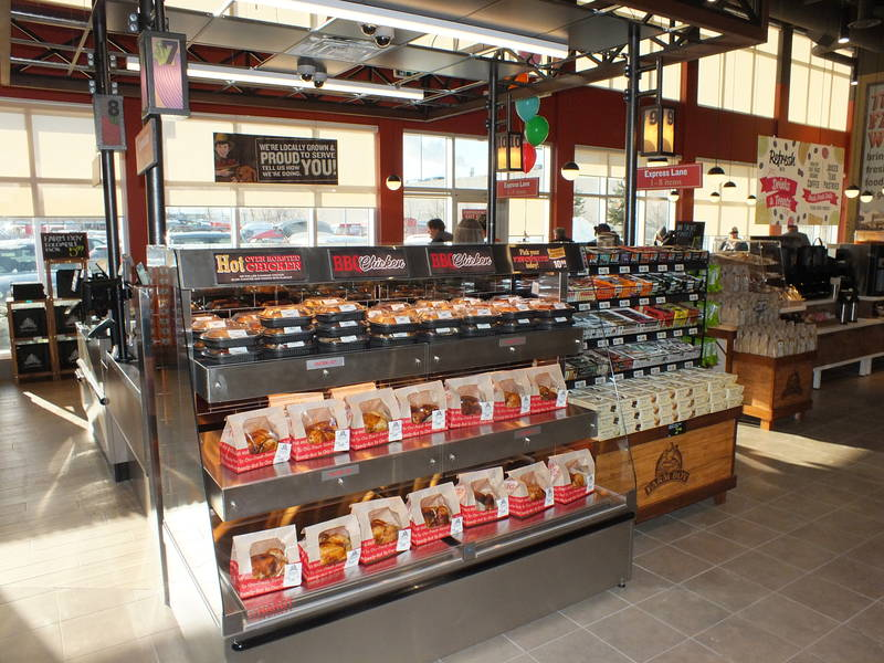 "Roasted chicken pickup is positioned by the cashier area for yet another quick and convenient ""grab and go"" meal option for shoppers"