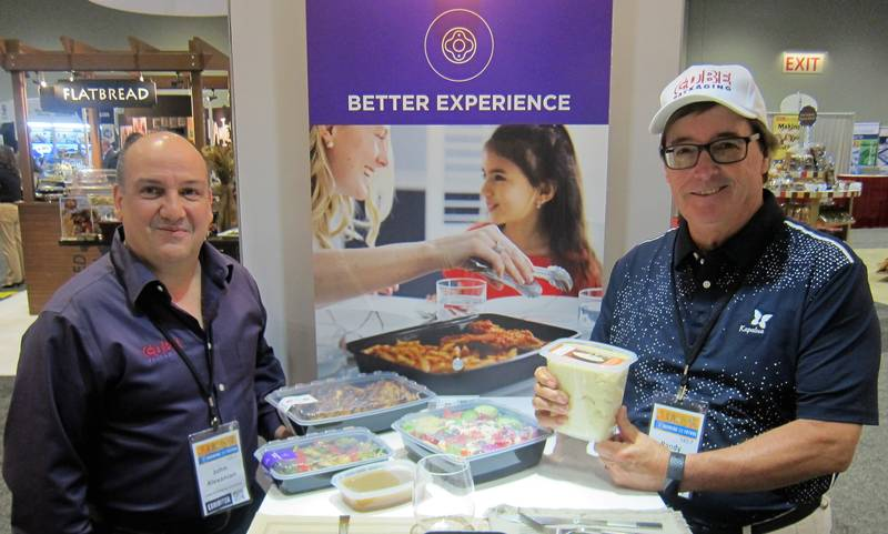 John Alexanian and Randy Heaton at the Cube Packaging booth
