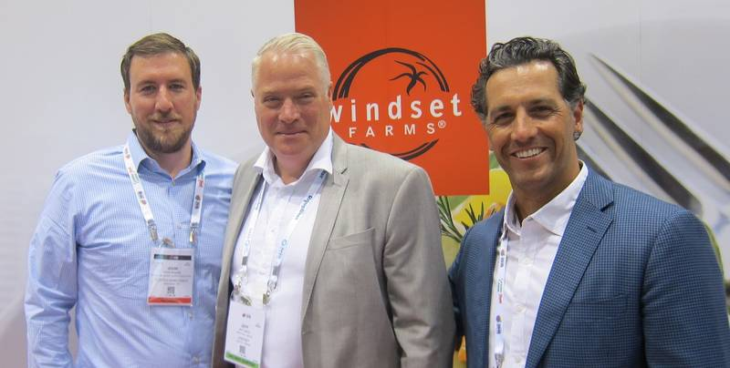 John Higgins, Costco buyer visiting Jeff Madu and Matt Madena at the Windset Farms booth