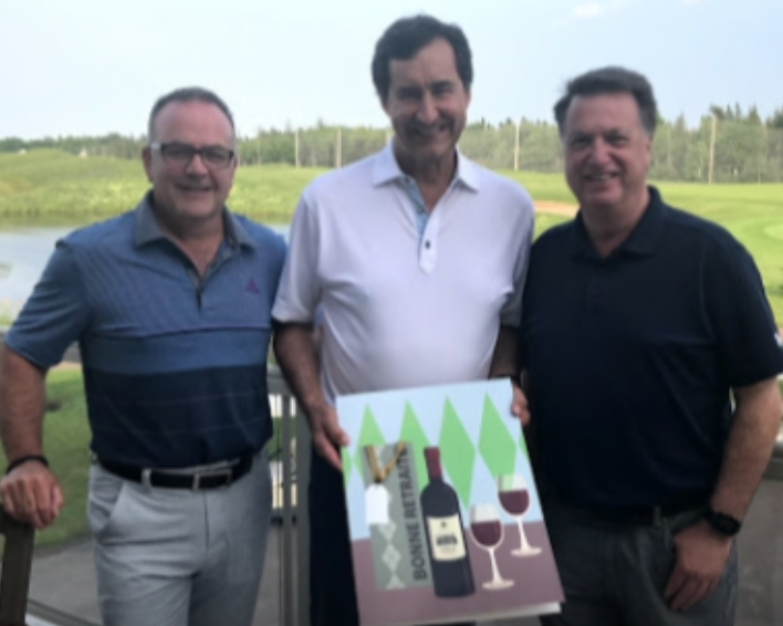 L R Francois Lavigne, Carlton Cards, Francois J. Coutu of Jean Coutu with a specially designed Carlton Card to mark his retirement, and Ron Sturtridge, Carlton Cards