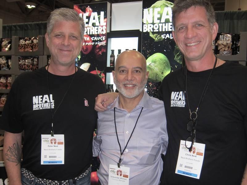 Ishkander Ahmed of Choices Market is bookended by Peter (left) and Chris Neal, Neal Brothers