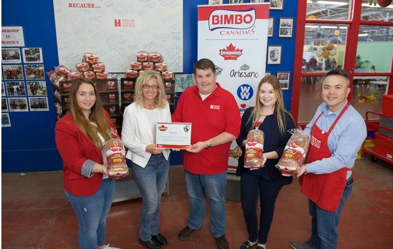 Dempster's donates to the North York Harvest Food Bank. L to R: Sylvia Sicuso, communications lead, Bimbo Canada; Lynn Langrock, vice president, human relations, Bimbo Canada; Ryan Noble, executive director, North York Harvest Food Bank; Heather McNeil Baker, communications, Bimbo Canada; Henry Chiu, director of development & marketing, North York Harvest Food Bank.