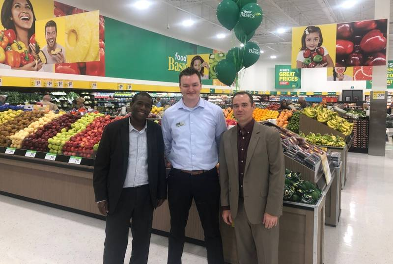 L to R: Gary Spencer, Food Basics director of retail execution; store manager Brennan Rows; Chris MacDonald, Food Basics senior director of operations