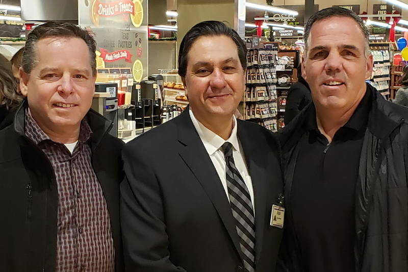 Farm Boy store manager Gino Caputo, centre, with Arnegs Stuart Feere, left and Ray Nutley