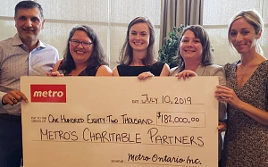 Carmen Fortino (l) presents a Metro cheque for $182,000 to representatives from a variety of charities: Krysta Doskoch, Rachel Dixon, Corey Smith and Rylee Cooper
