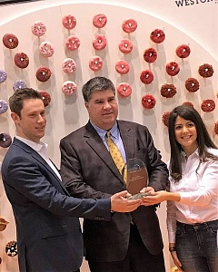 From left: Jared Kwart, director of marketing, Weston Foods; Dickie Brennan, National Restaurants Association show chair; and Sonya Marques, marketing manager, North America Foodservice, Weston Foods.